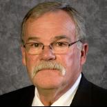 John E. Barker Profile